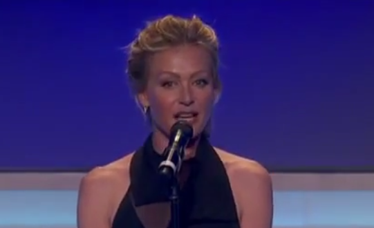 Portia de Rossi presents to GLAAD President Sarah Kate Ellis at the #glaadawards